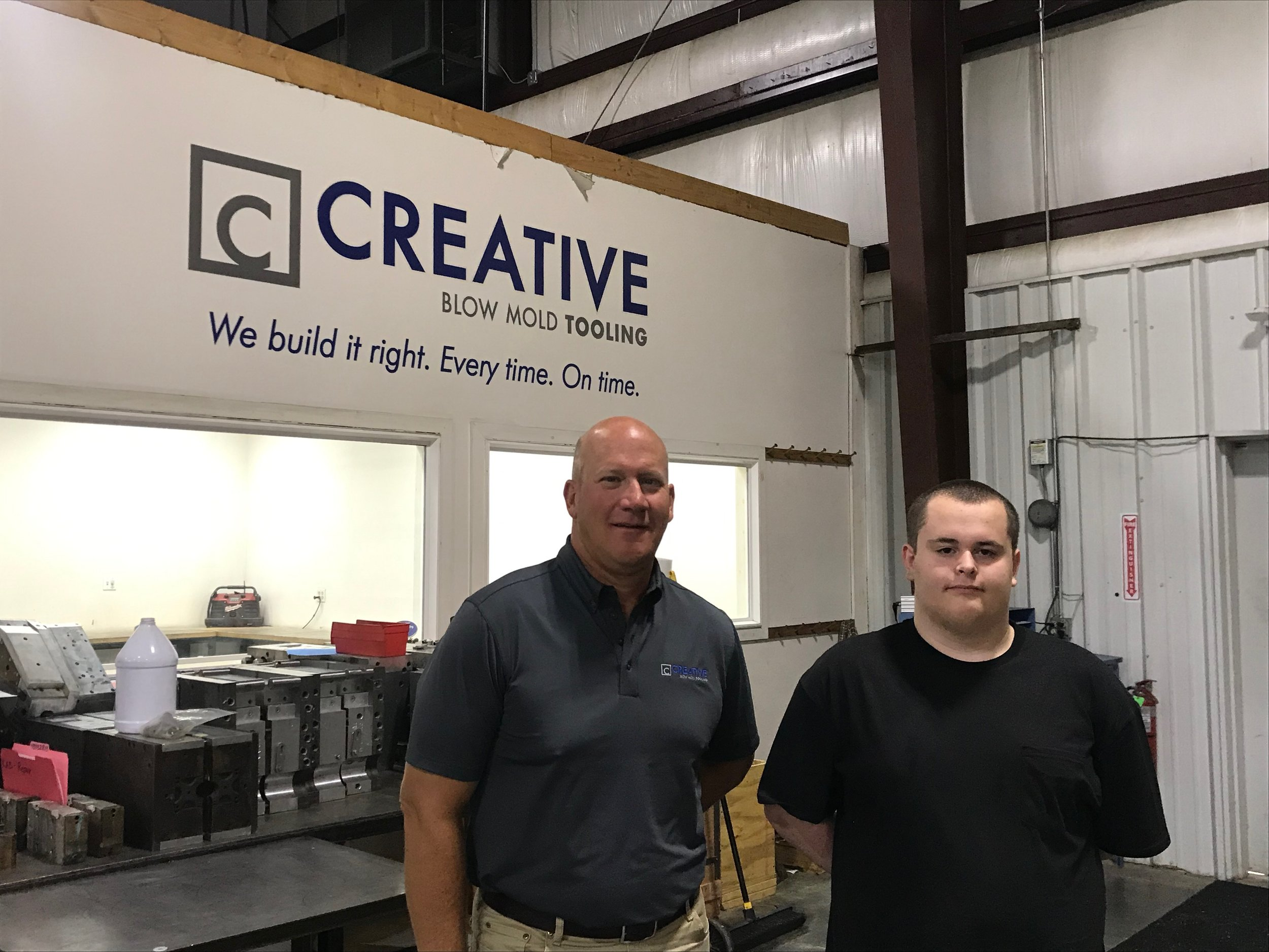 Creative Blow Mold Tooling owner Michael Bohning (left) said Colby Jacquemin's career exposure before starting at Creative Blow Mold Tooling helped him develop a mechanical aptitude that quickly made him a contributing part of the team. ( Photo courtesy Lee's Summit Economic Development Council)