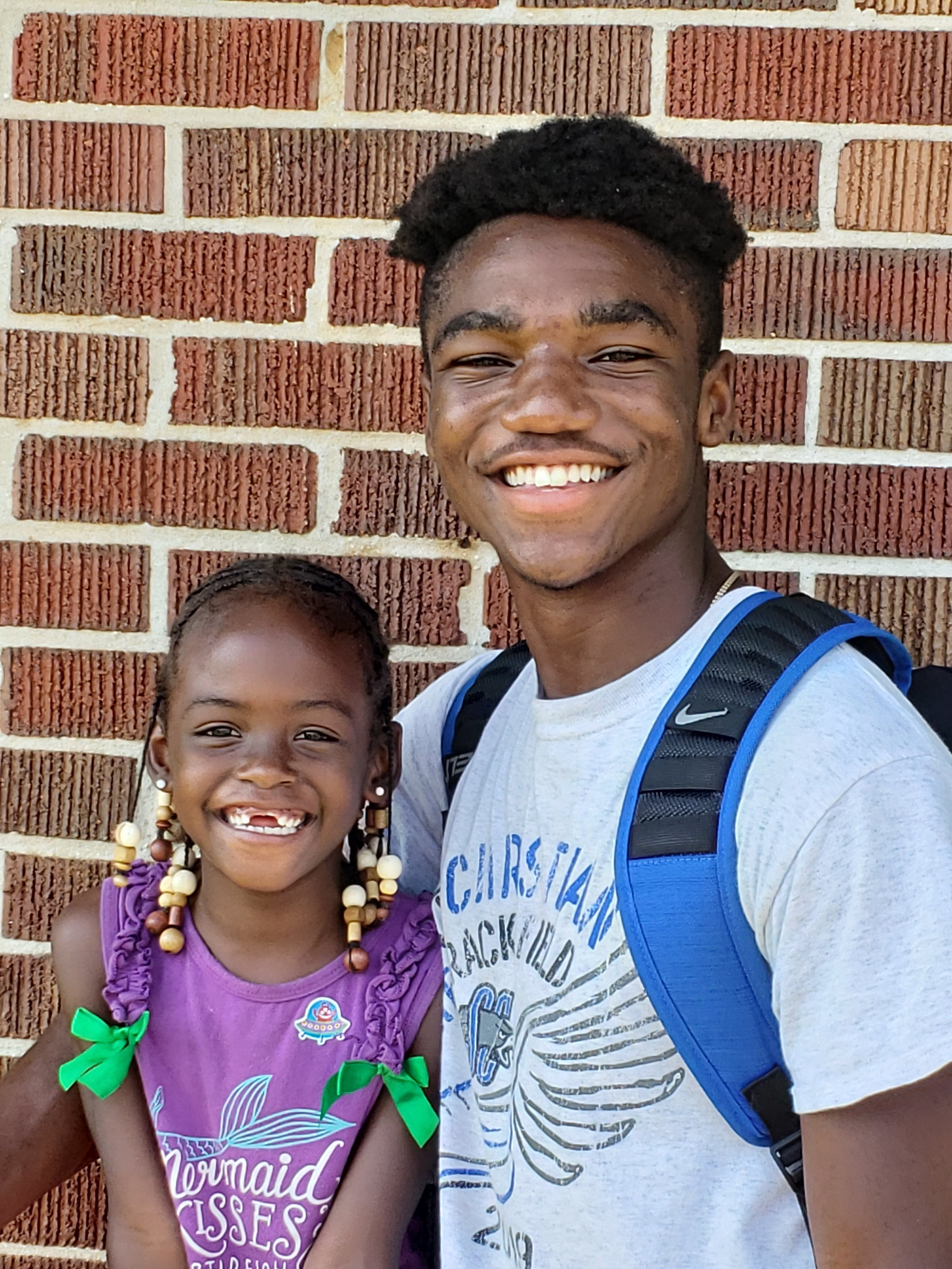 SCA Senior Isaiah Cahimba enjoys time working with a student at the Megan Kelley Dream Center in Alabama as part of the annual SCA senior mission trip. ( Photo courtesy Summit Christian Academy )