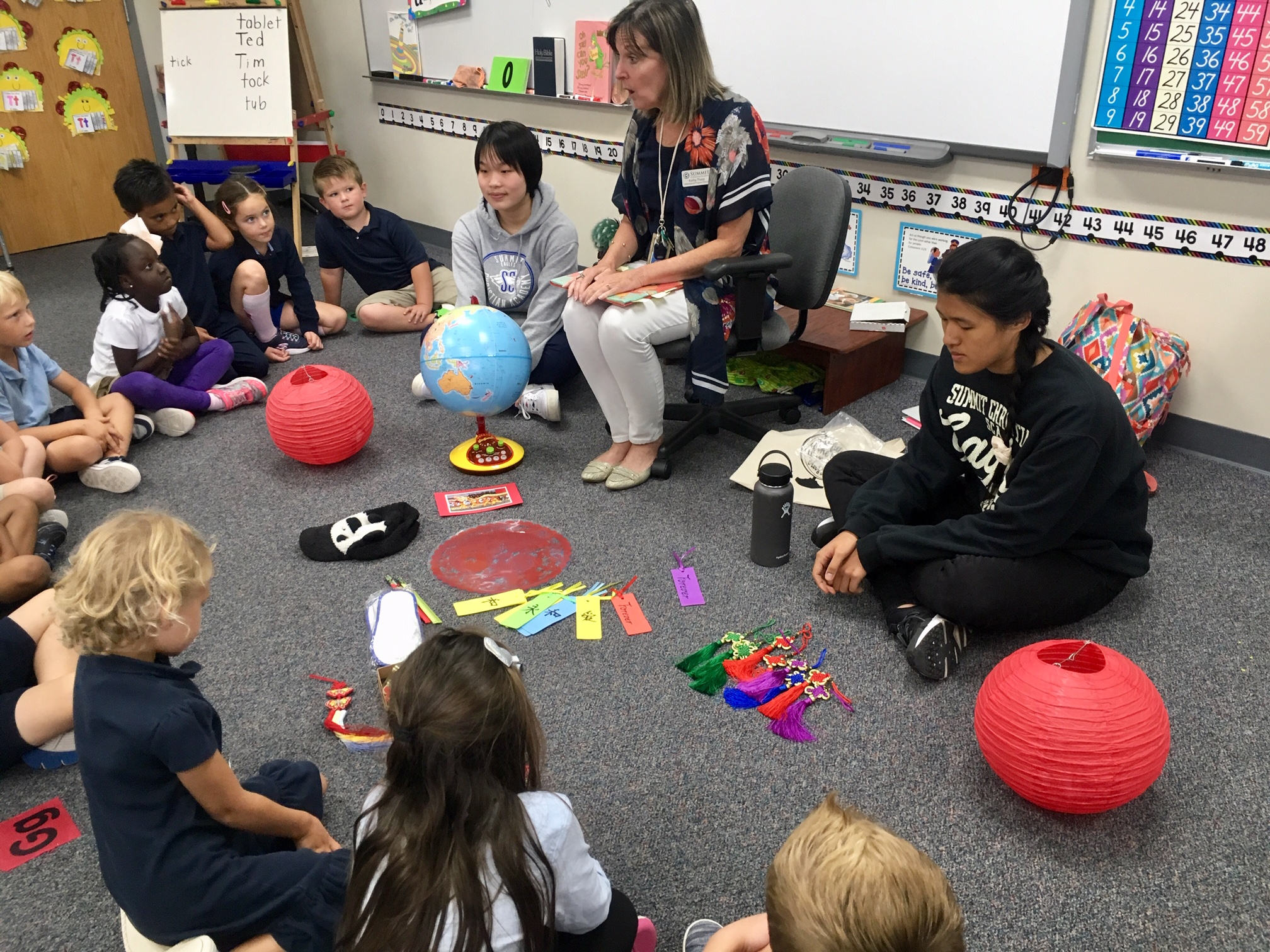 SCA Senior and International Student, Teresa Xiong, shared Chinese props with SCA Kindergarten students. Teresa is an International student at SCA and is interning with Mrs. Tharp. ( Photo courtesy Summit Christian Academy )