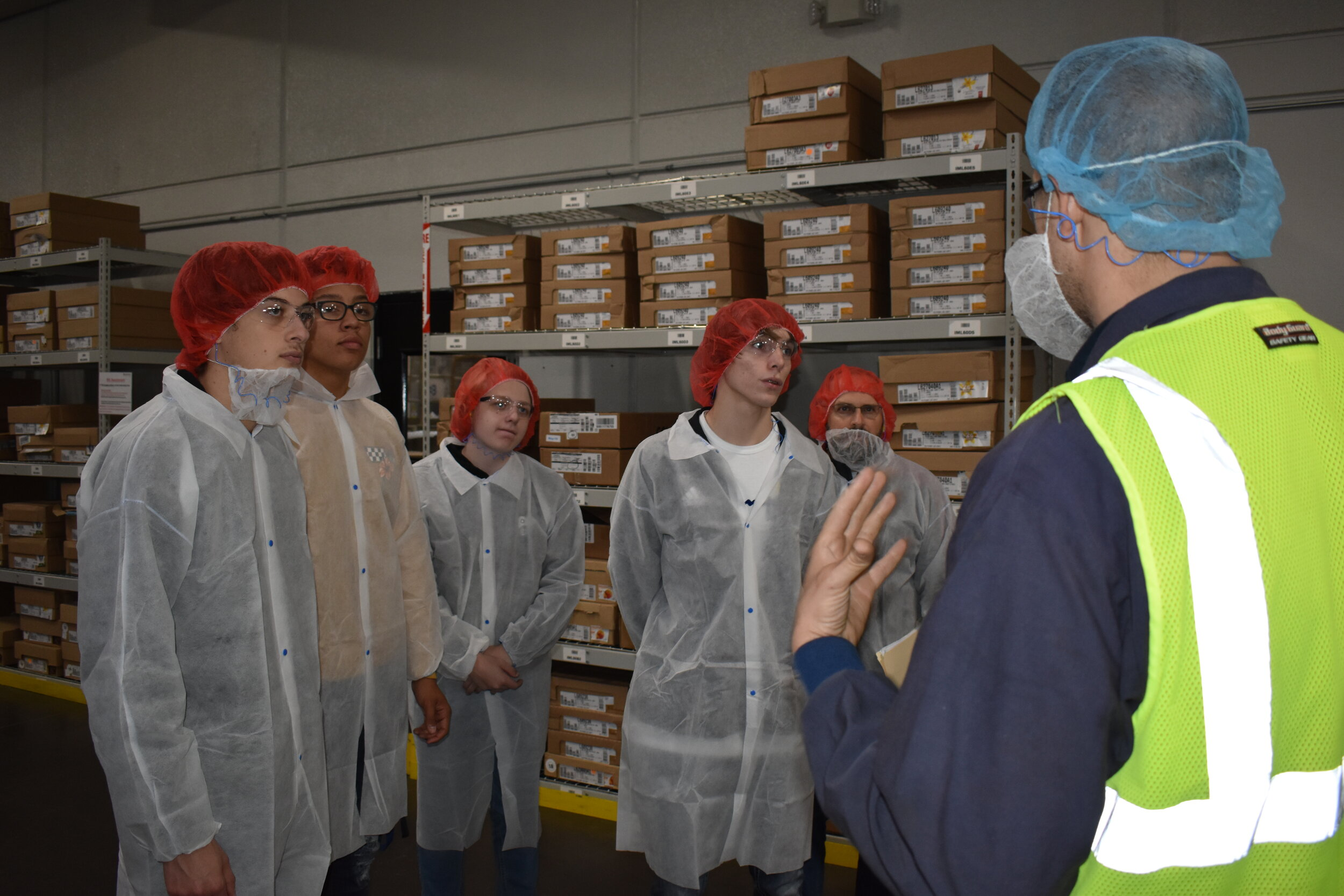 Students from Lee's Summit North High School, Summit Christian Academy and Saint Michael the Archangel Catholic High School were offered a unique chance to learn about the career opportunities available in modern manufacturing. Students toured Polytainers and ULTRAX Aerospace as part of National Manufacturing Day. ( Photo courtesy LS EDC )