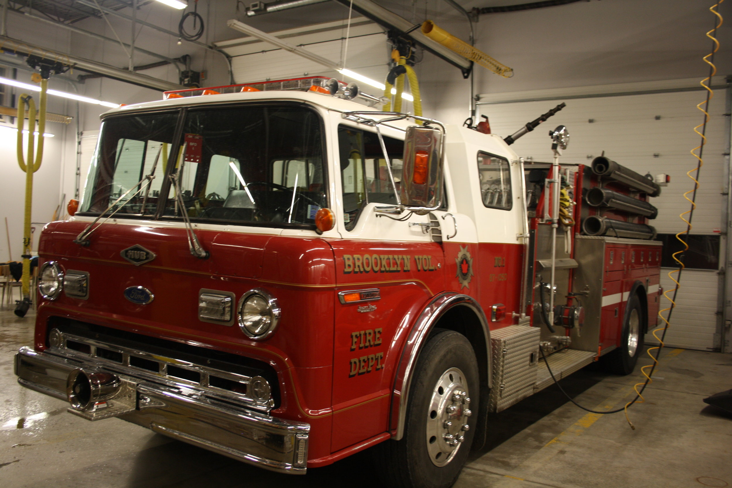Truck one is a 1987 Ford 8000 / Hub Pumper with a 1050 GPM pump and has 800 gallons of water on board.