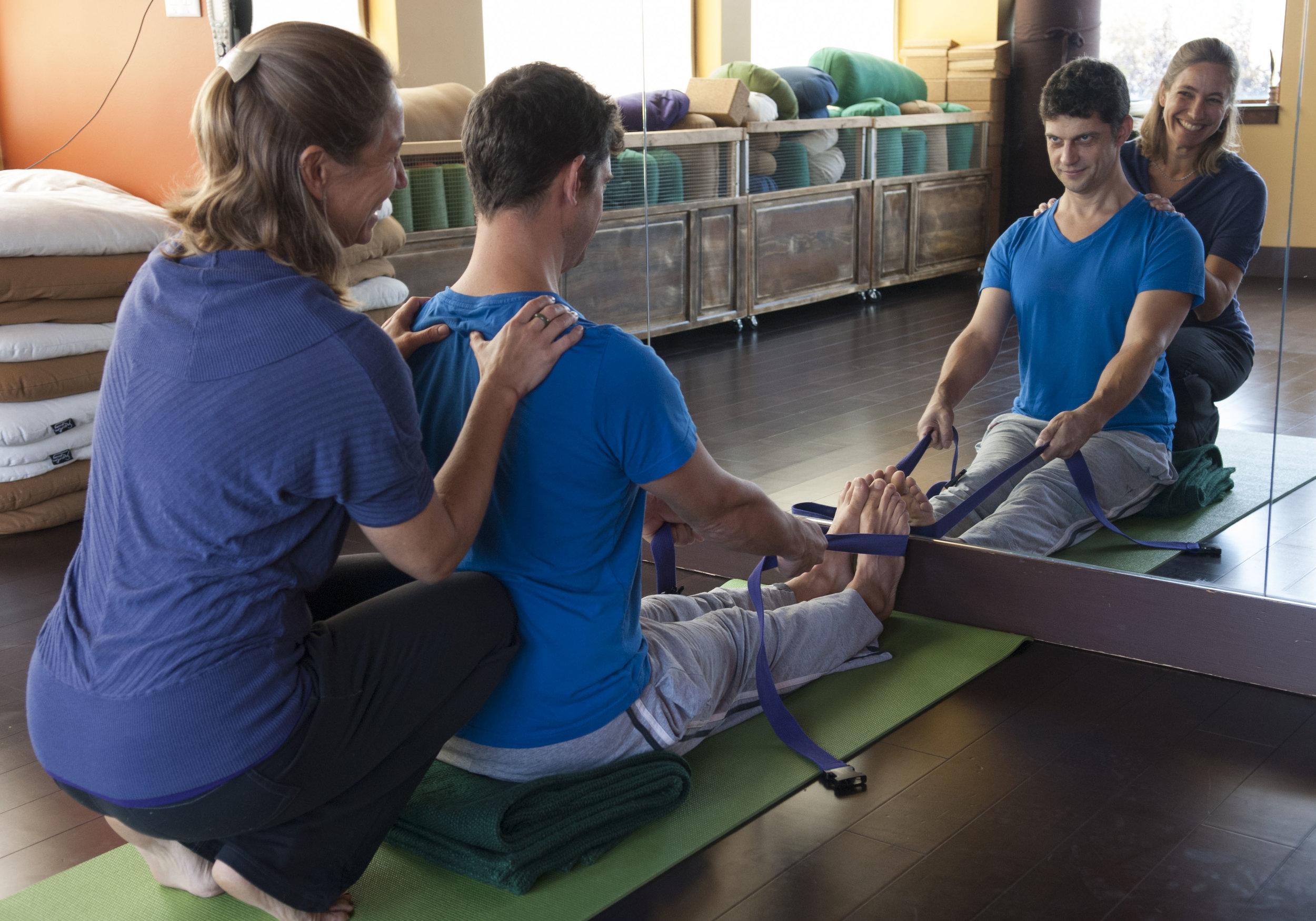 teaching yoga to Tim
