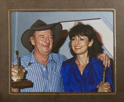 Anne Kirkpatrick with her dad 'Slim Dusty' at Tamworth 1991.jpg
