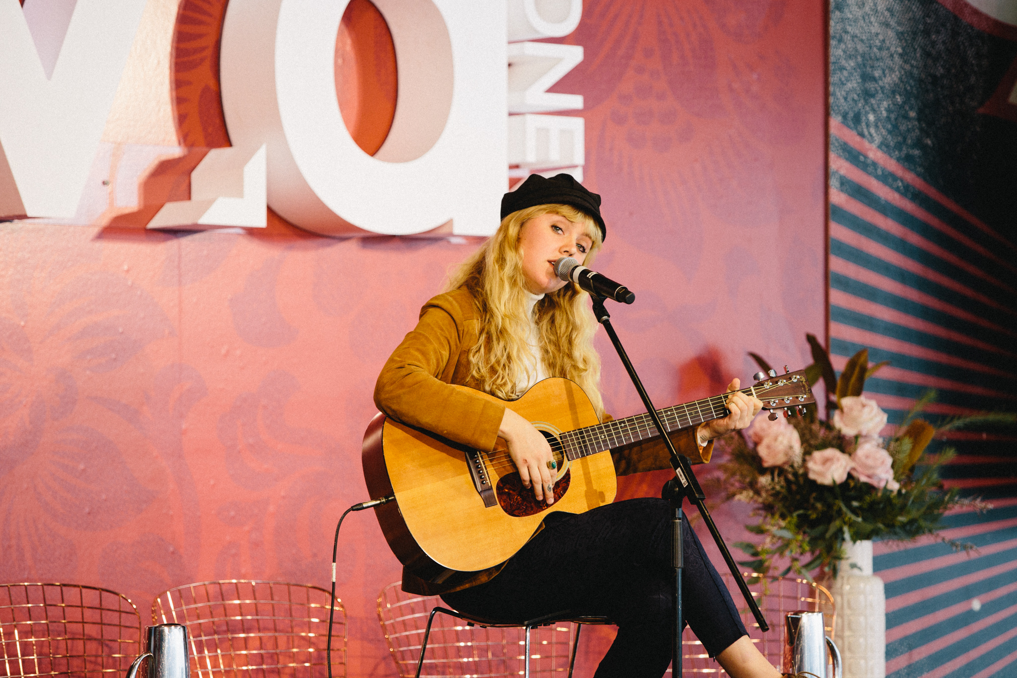 Iluka sings at Pathway to Platform after performing into the wee hours for Killing Heidi the night before. Image Mikki Gomez for Music Love Australia