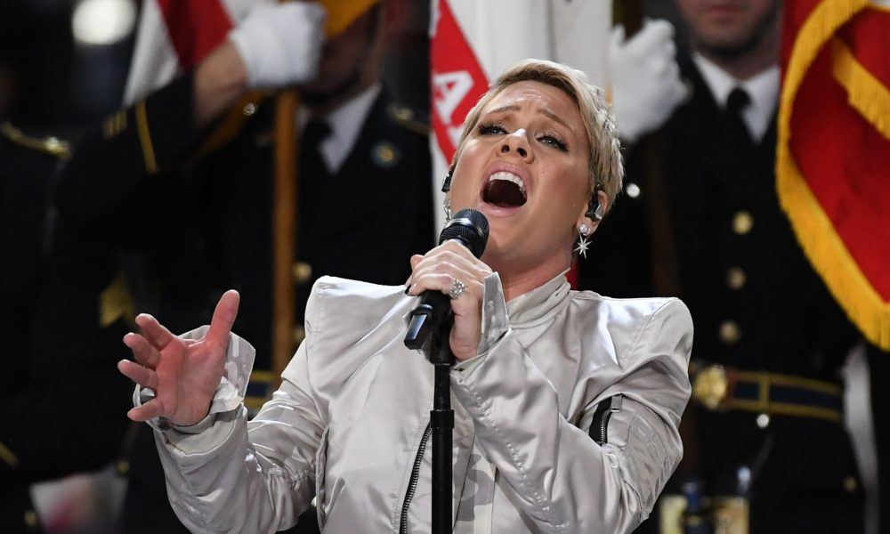 Pink performs the American national anthem at the 52nd Super Bowl on Sunday. Image via USA Today.