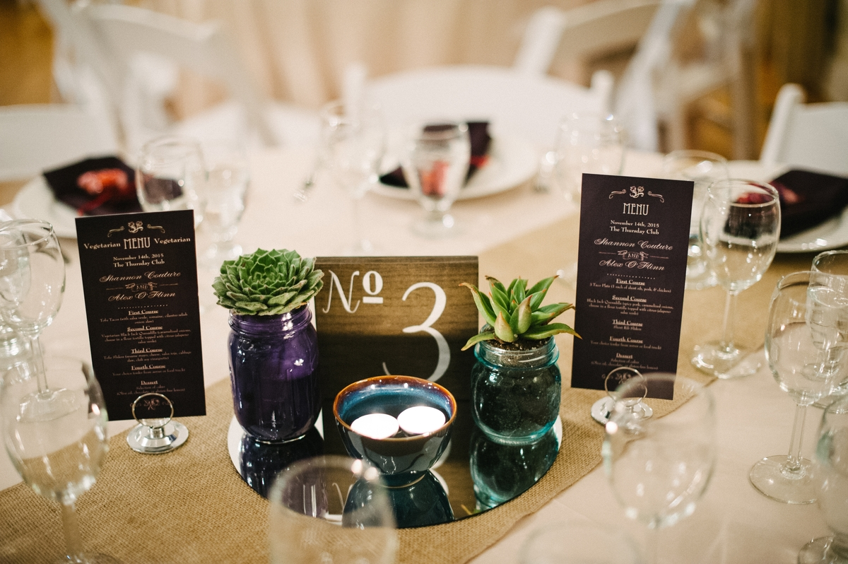 This couple created cute take-home centerpieces that could be made ahead and looked really modern and sleek. No stress, no mess, super easy and guests were charmed. Photo by  Hanna Arista.