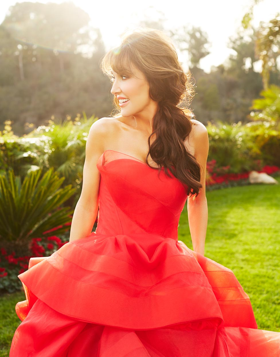 Mark DeLong - Celebrity Photographer - Actress wearing a red dress outside in greenery.