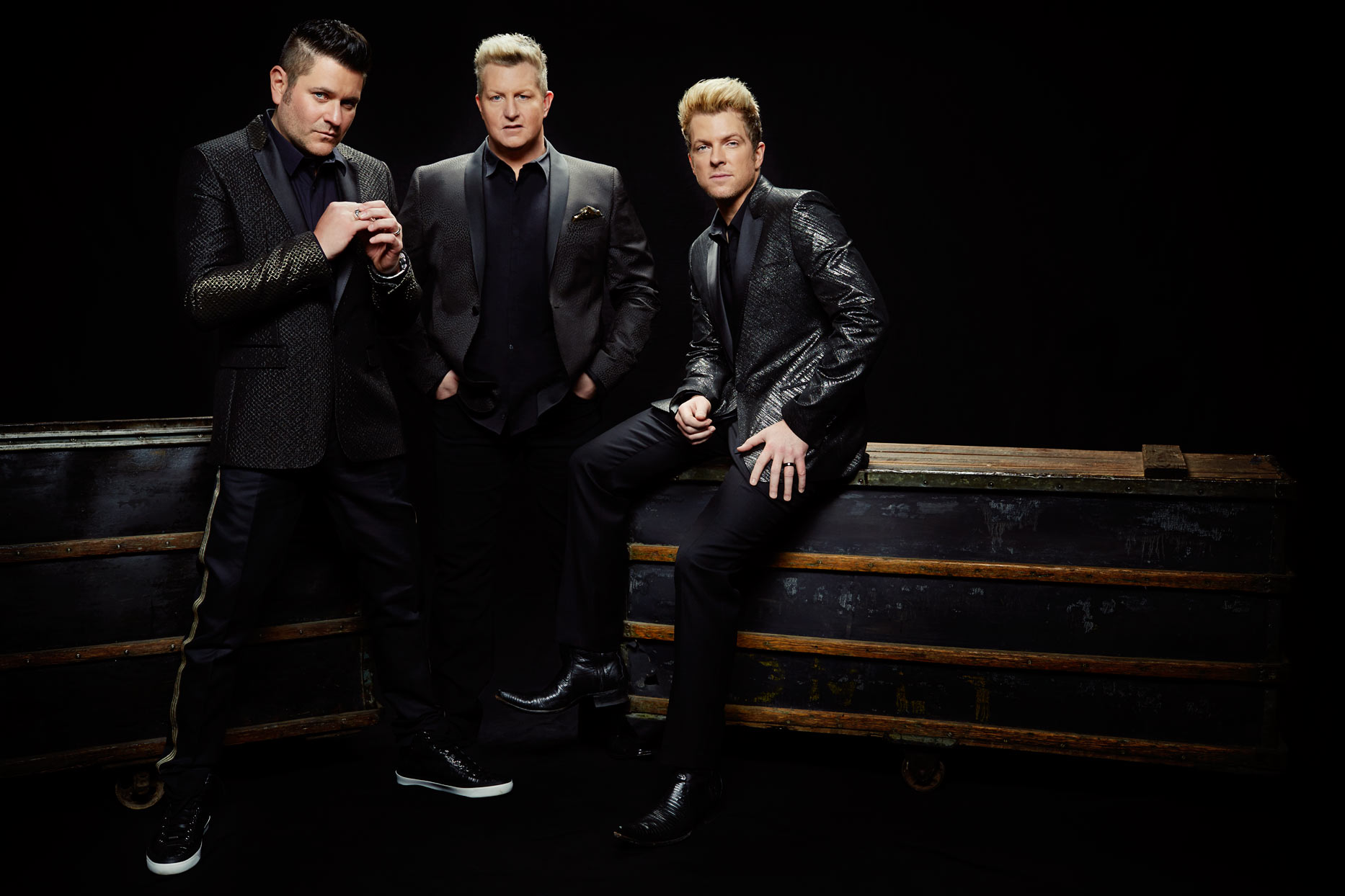 Mark DeLong - Celebrity Photographer - 3 Musicians in black suits relaxing together.