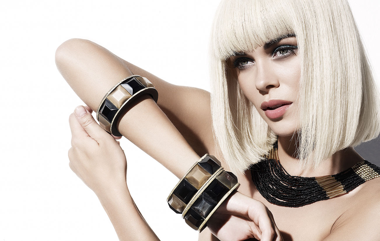 Blond woman with short hair wearing large black and tan tile bracelets - Mark DeLong: Fashion Gallery