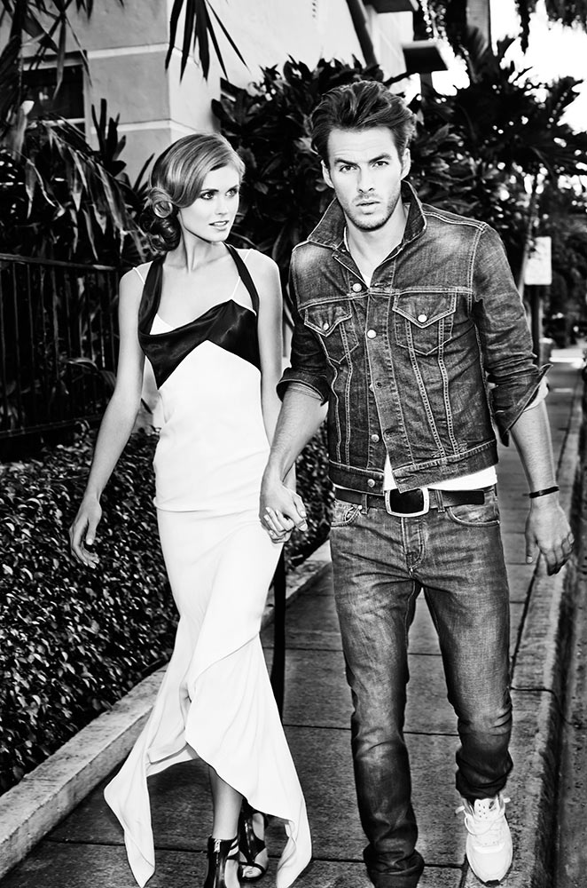 Mark DeLong - Lifestyle Photography - Man in a all denim outfit holding hands with a woman in a black and white dress walking down the sidewalk