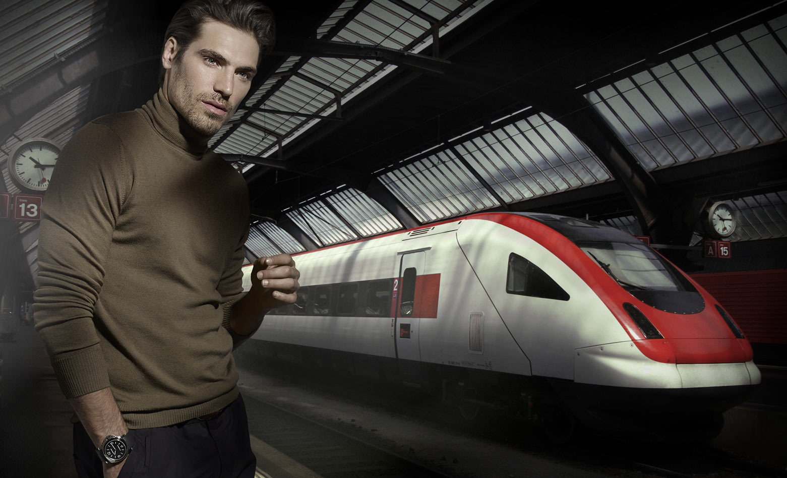 Mark DeLong - Commercial Photography - Man in a green sweater stands near red and white tram.