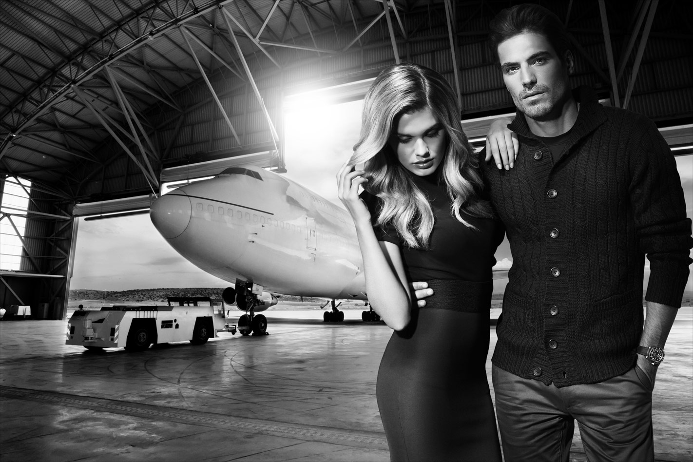 Mark DeLong - Commercial Photography - Gray scale photo of couple near a jet.