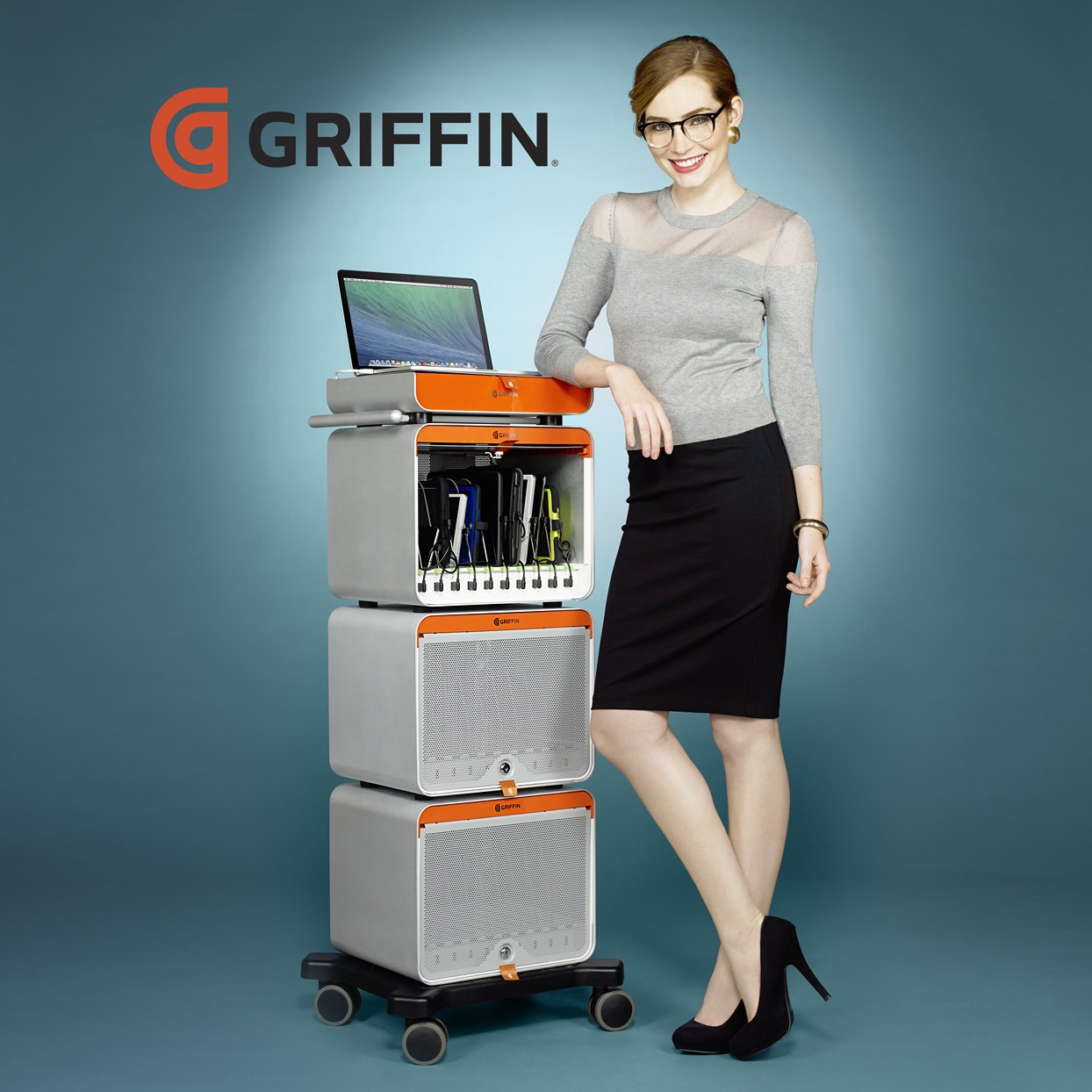 Mark DeLong - Commercial Photography - Business Woman next a Griffin desk.