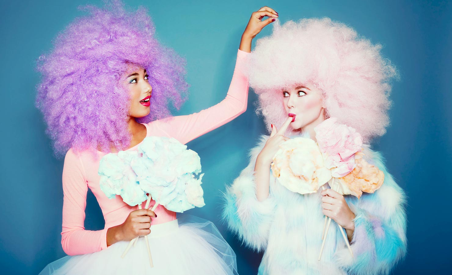 Mark DeLong - Commercial Photography - Two girls with poofy pink and purple hair.