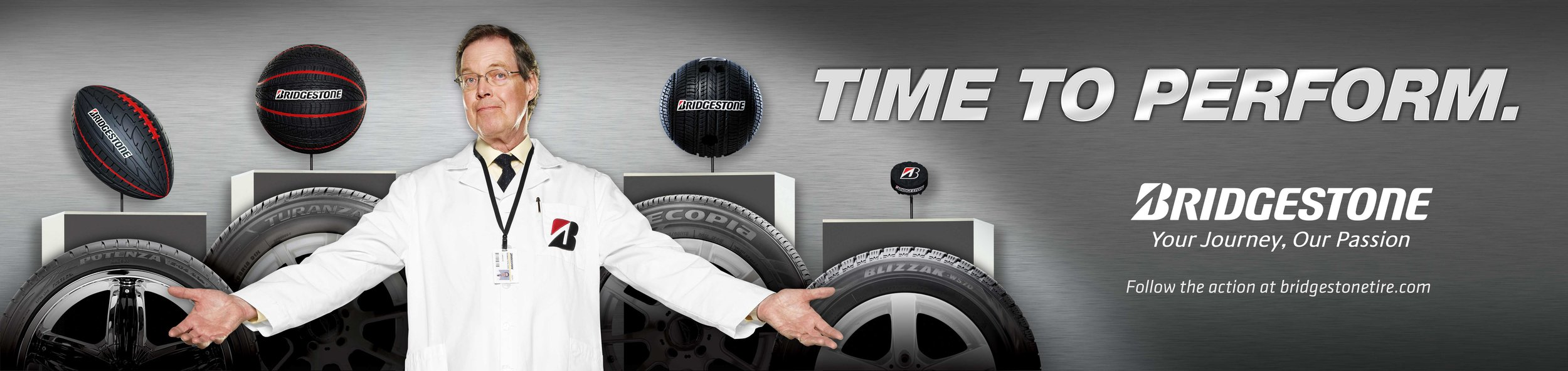 Mark DeLong - Commercial Photography - Different sports balls displayed over tires with a man in a white coat standing with his arms open.