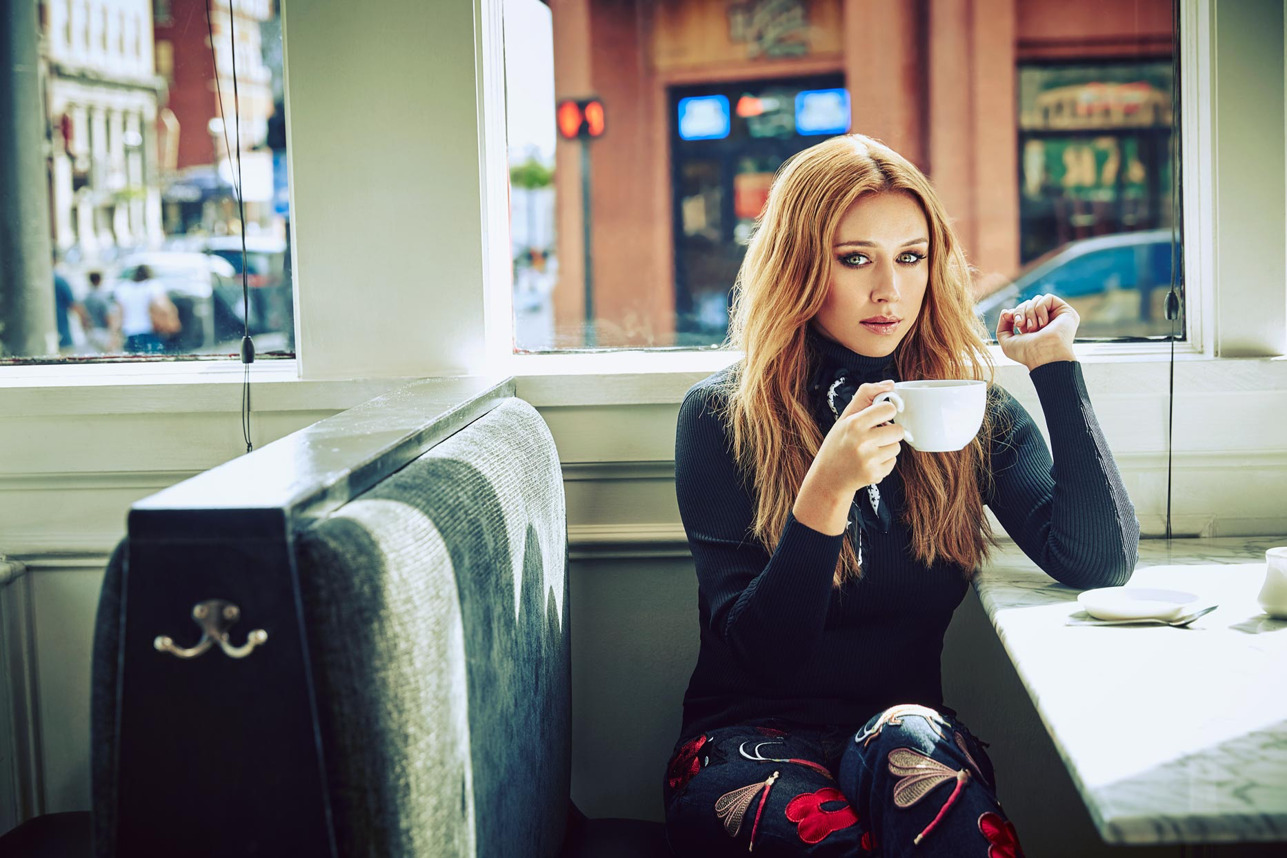 Mark DeLong - Celebrity Photographer - Actress in a diner getting ready to sip coffee.