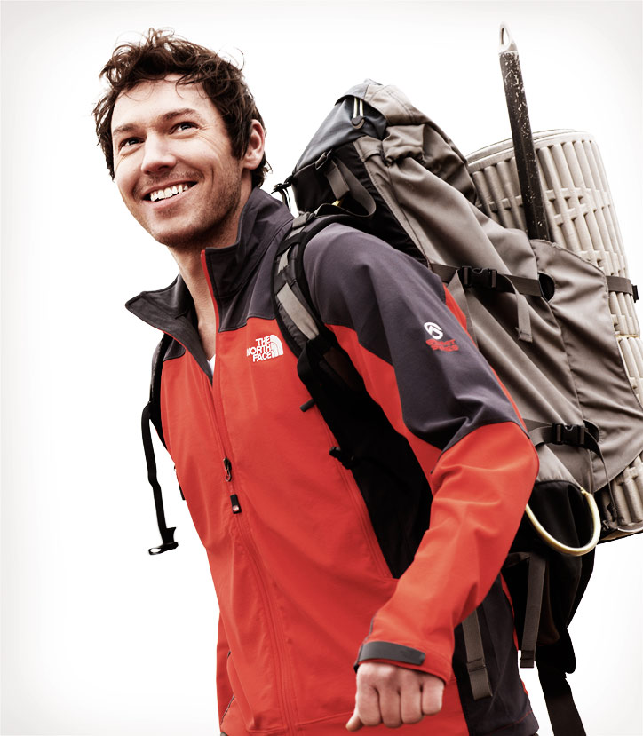 Mark DeLong - Lifestyle Photography - A man in a red and blue jacket with a camping backpack