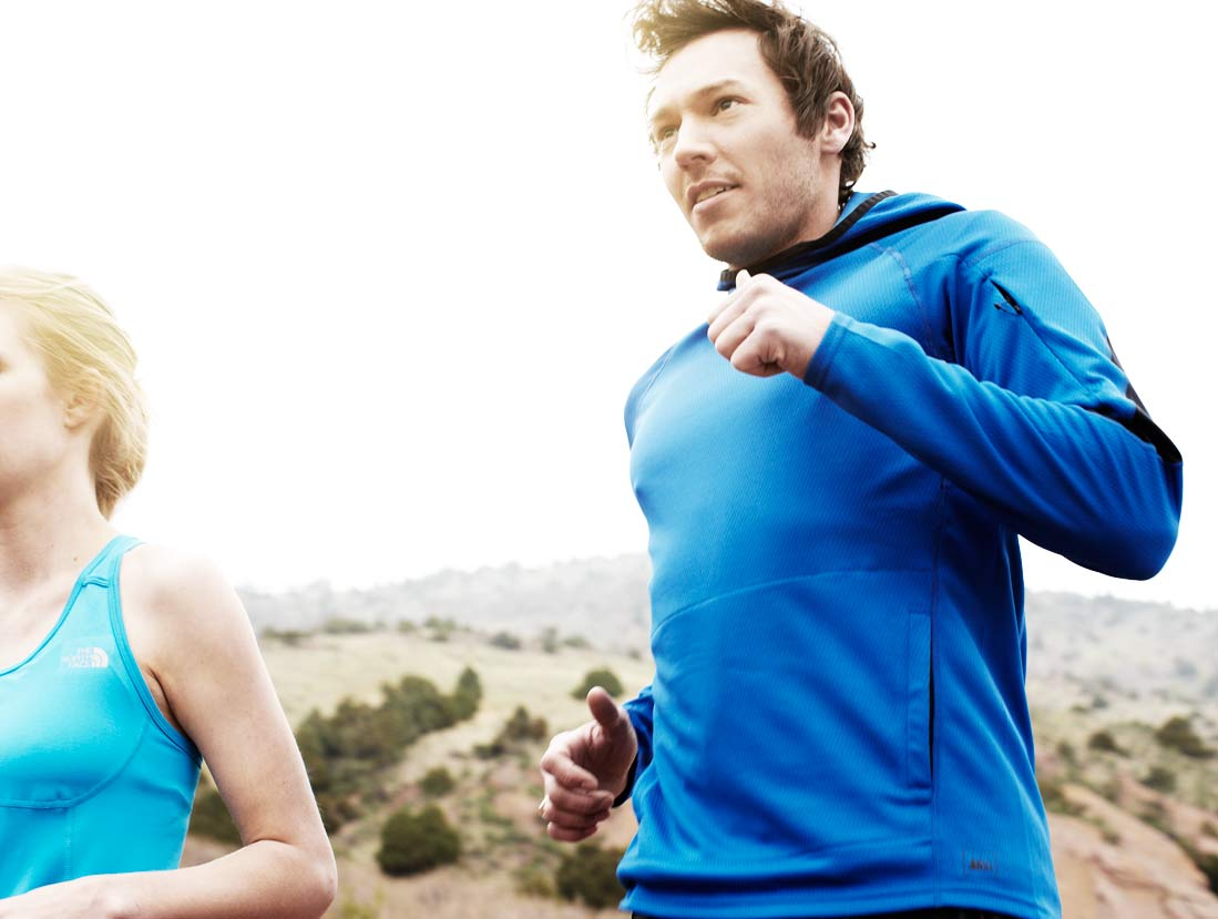 Mark DeLong - Lifestyle Photography - A man in a blue sweatshirt and a woman in a blue tank top on a run