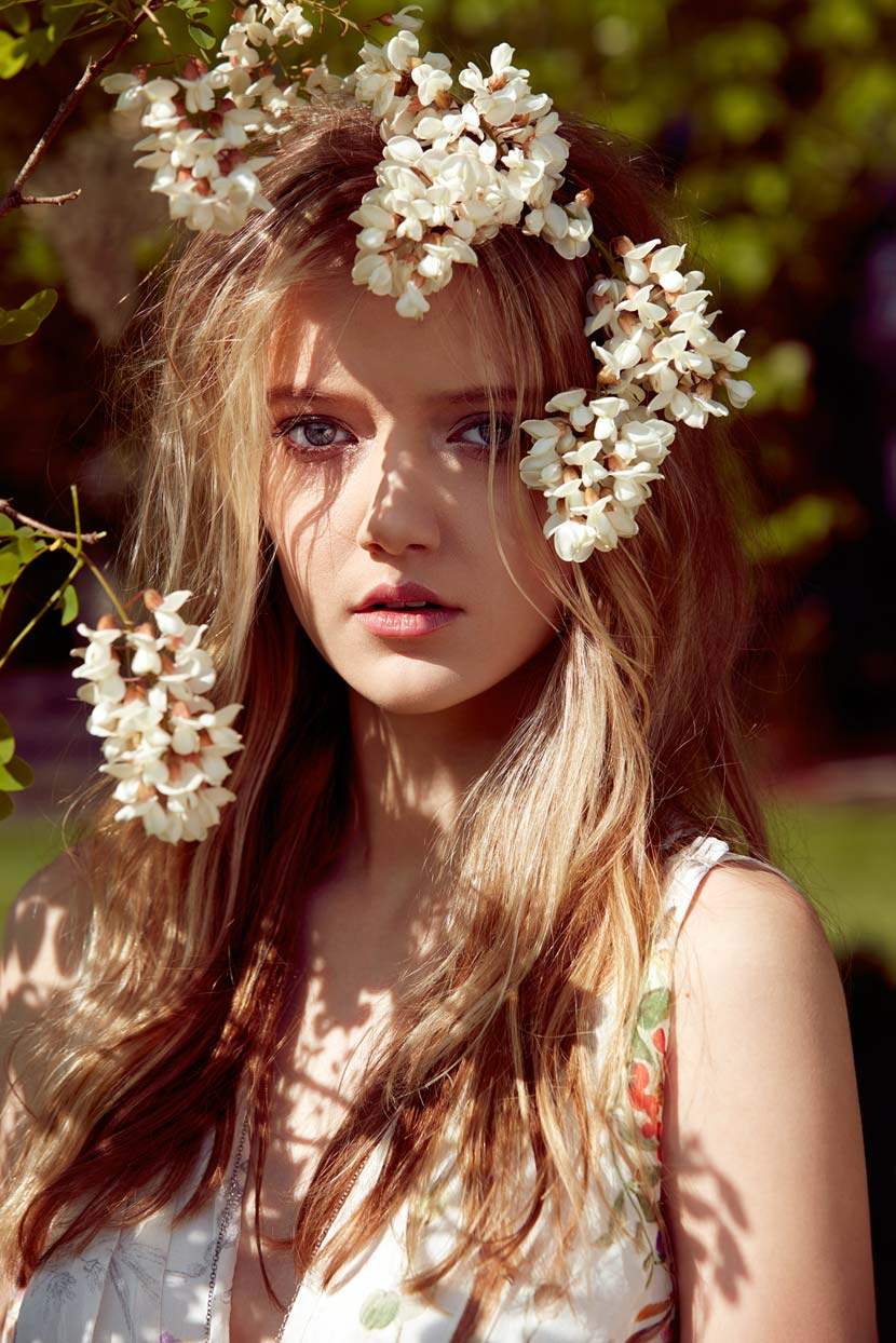 Portrait of girl with white flowers in dirty blond hair - Mark DeLong: Fashion Gallery