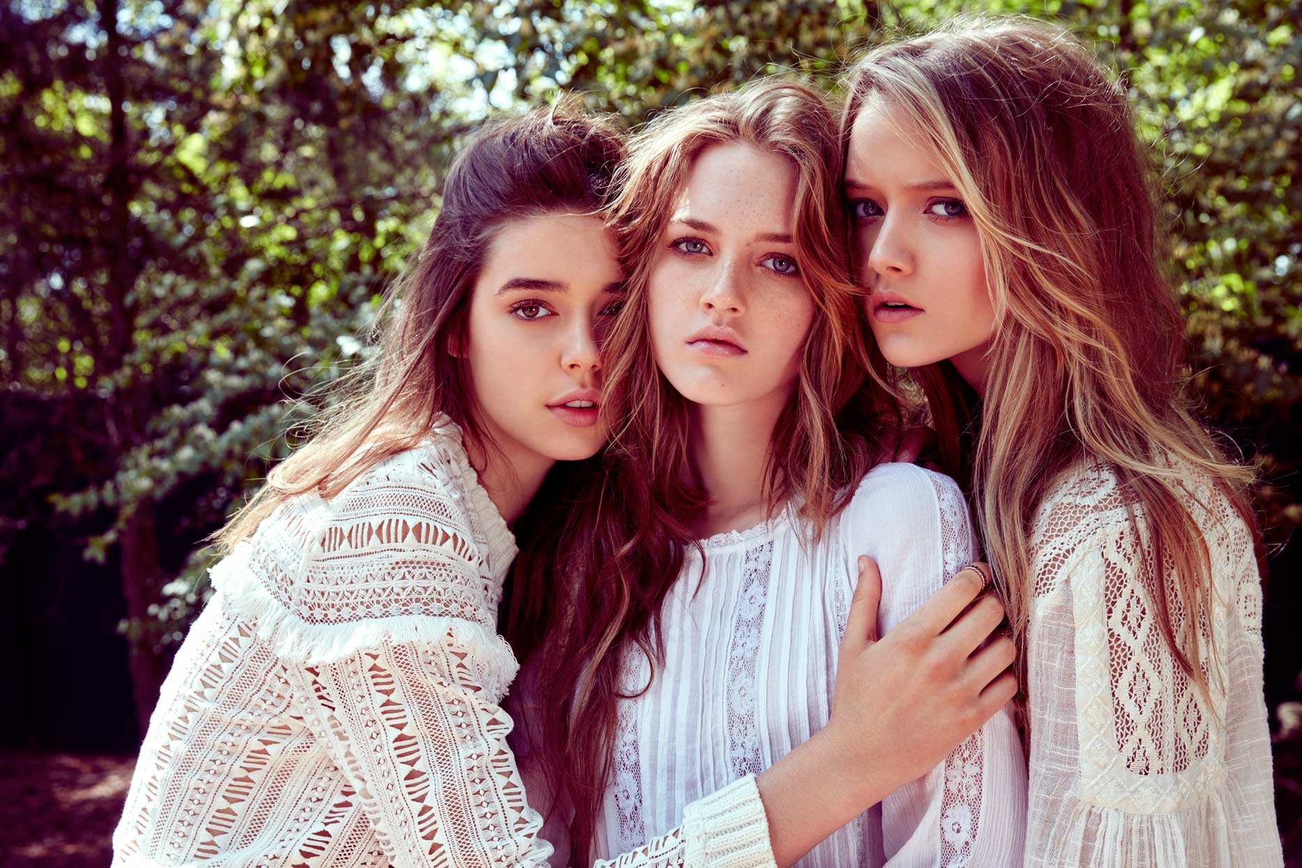 Three girls modeling all wearing white elegant tops - Mark DeLong: Fashion Gallery