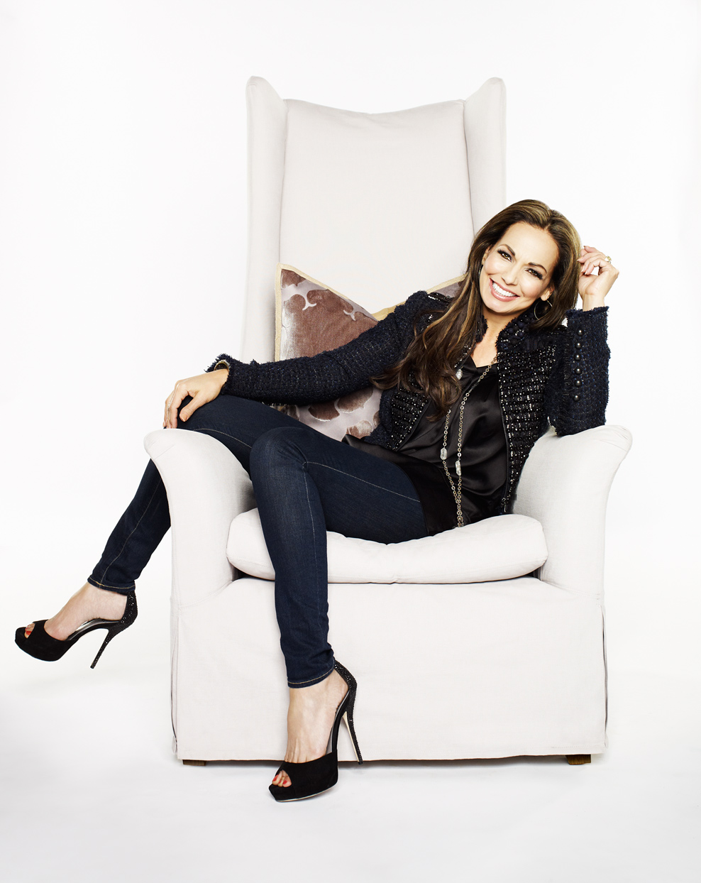 Mark DeLong - Celebrity Photographer - Actress sitting on a white chair.