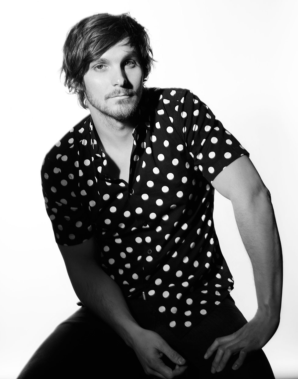 Mark DeLong - Celebrity Photographer - Black and white photo of an actor in a polka dot shirt.