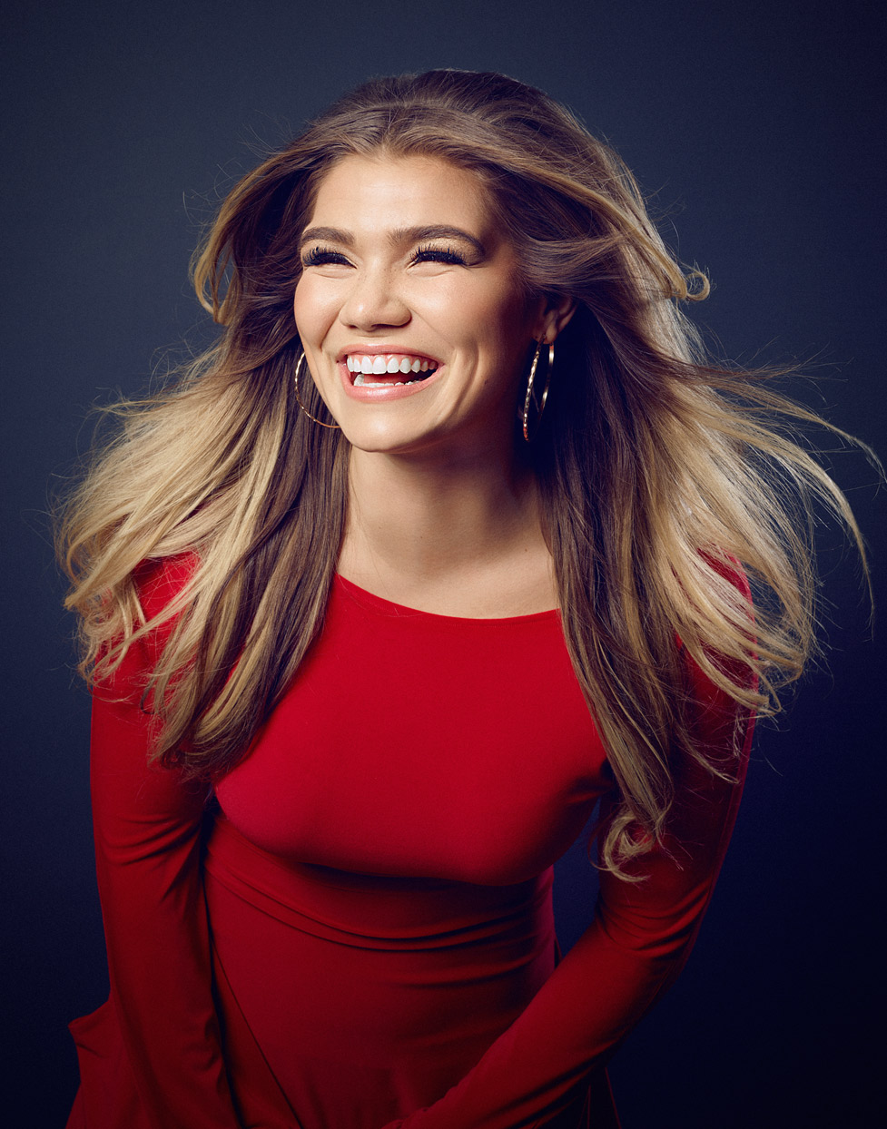 Mark DeLong - Celebrity Photographer - Actress in red dress laughing.
