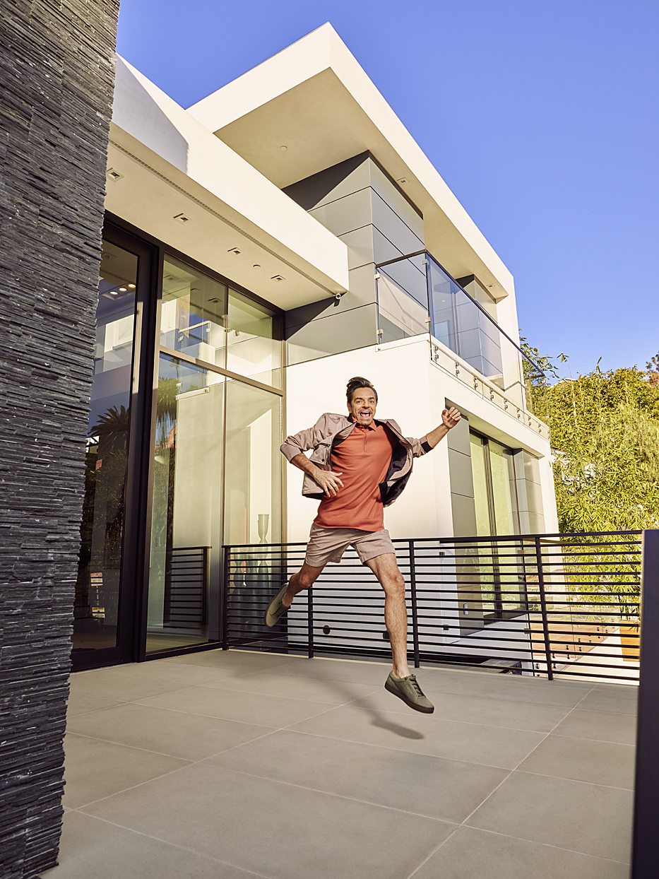 Mark DeLong - Celebrity Photographer - Actor running out of a modern building.