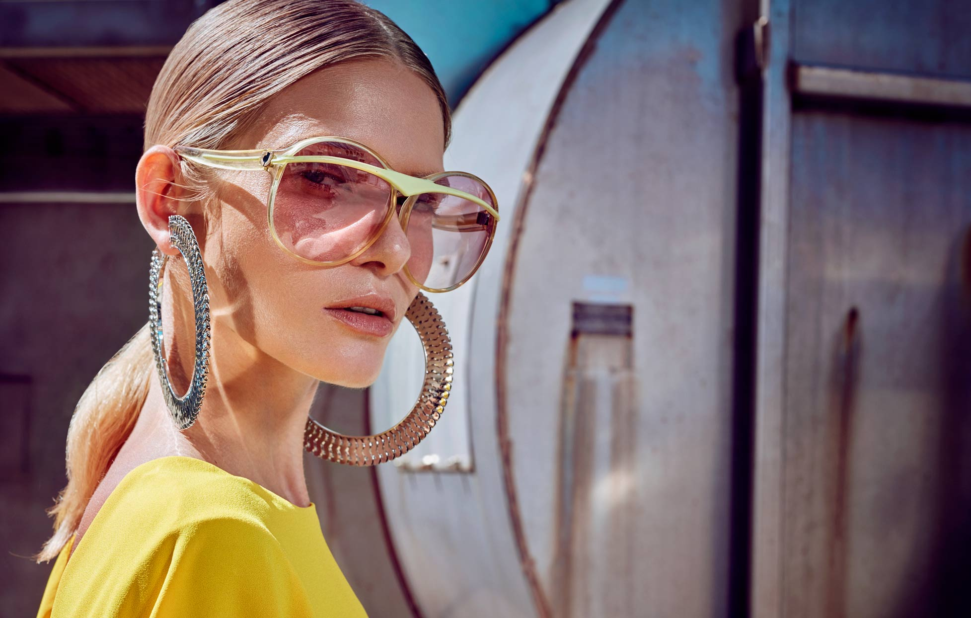 Hi fashion model wearing large metal hoop earrings and gold rim sunglasses - Mark DeLong: Fashion Gallery