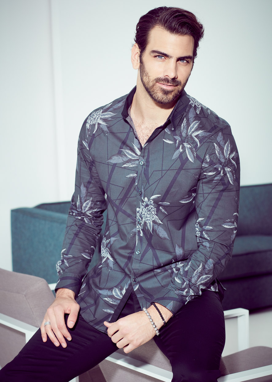 Mark DeLong - Celebrity Photographer - Actor wearing a grey Hawaiian shirt.