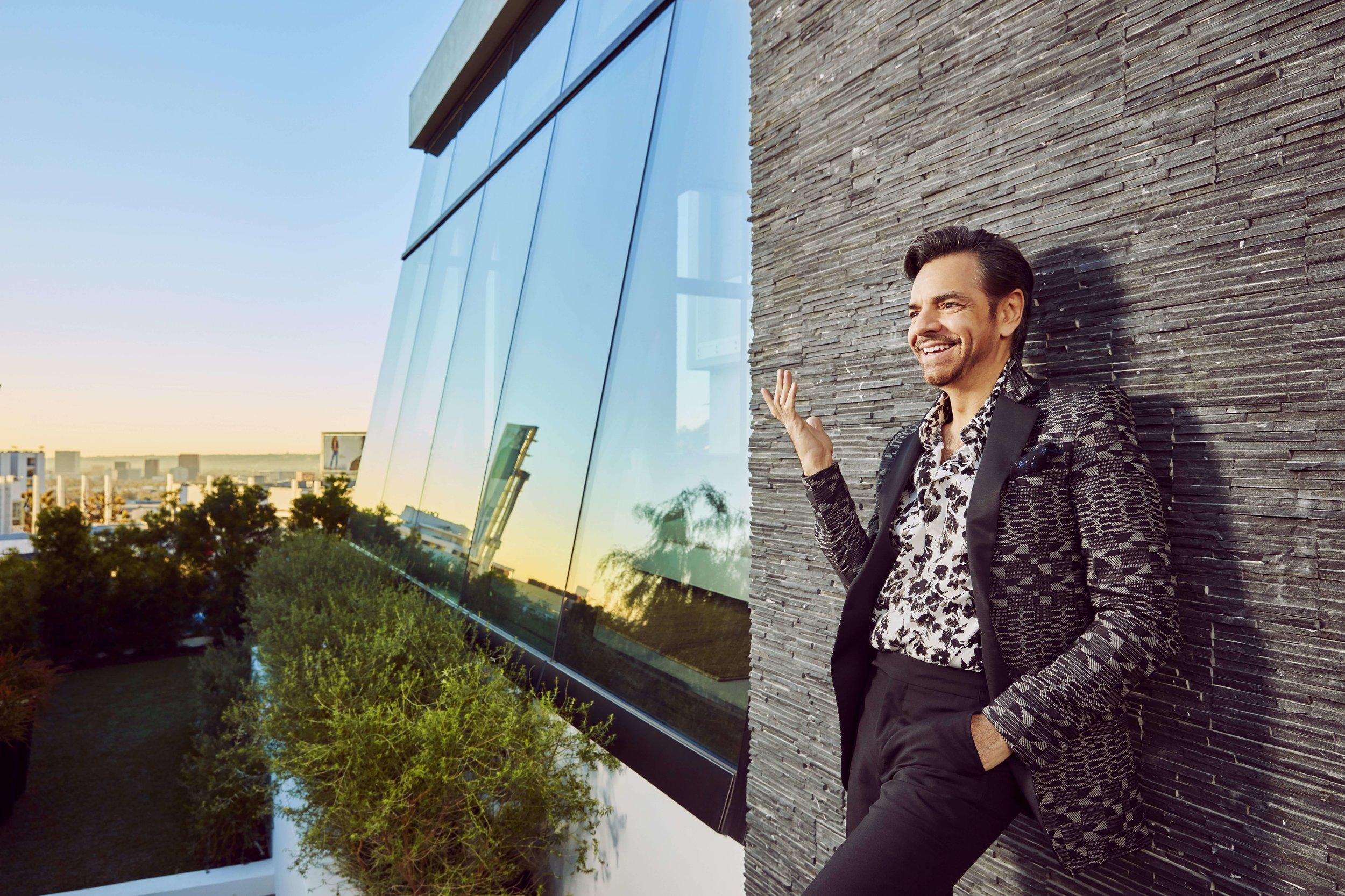 Mark DeLong - Celebrity Photographer - Actor outside leaning against modern building.