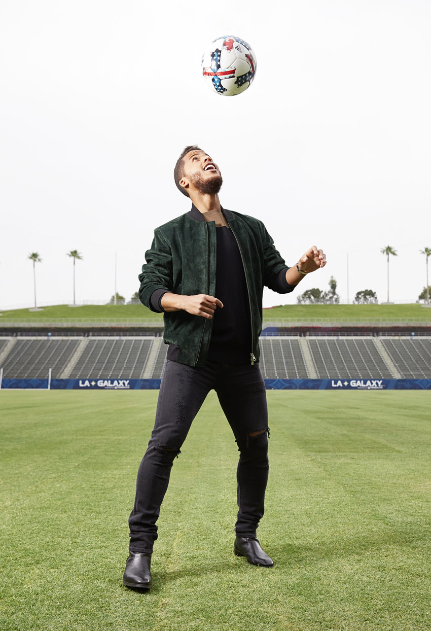 Mark DeLong - Celebrity Photographer - Male celebrity about to hit a soccer ball with his head.