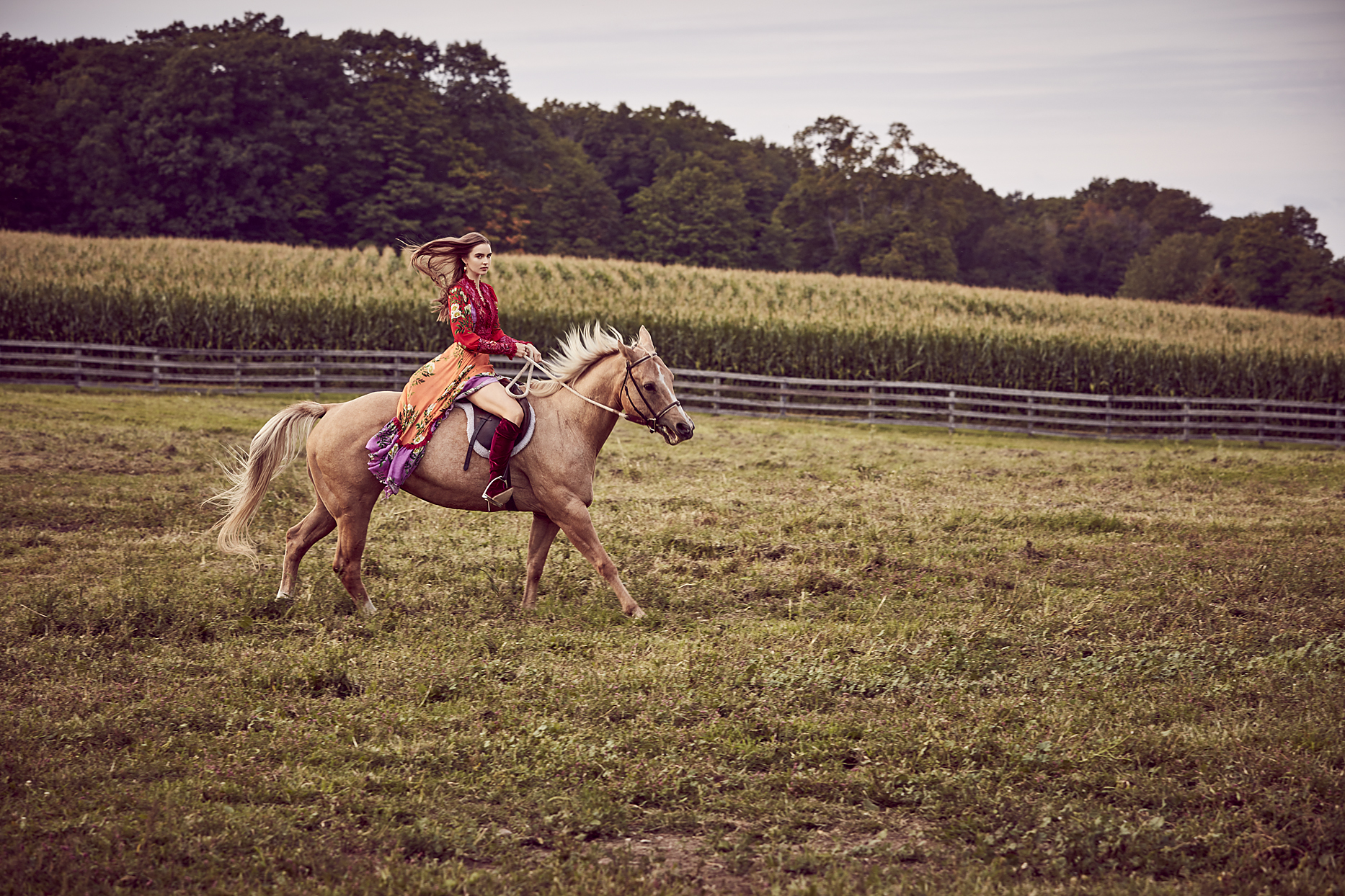 Woman with red boots riding a brown horse in a farm pasture - Mark DeLong: Fashion Gallery