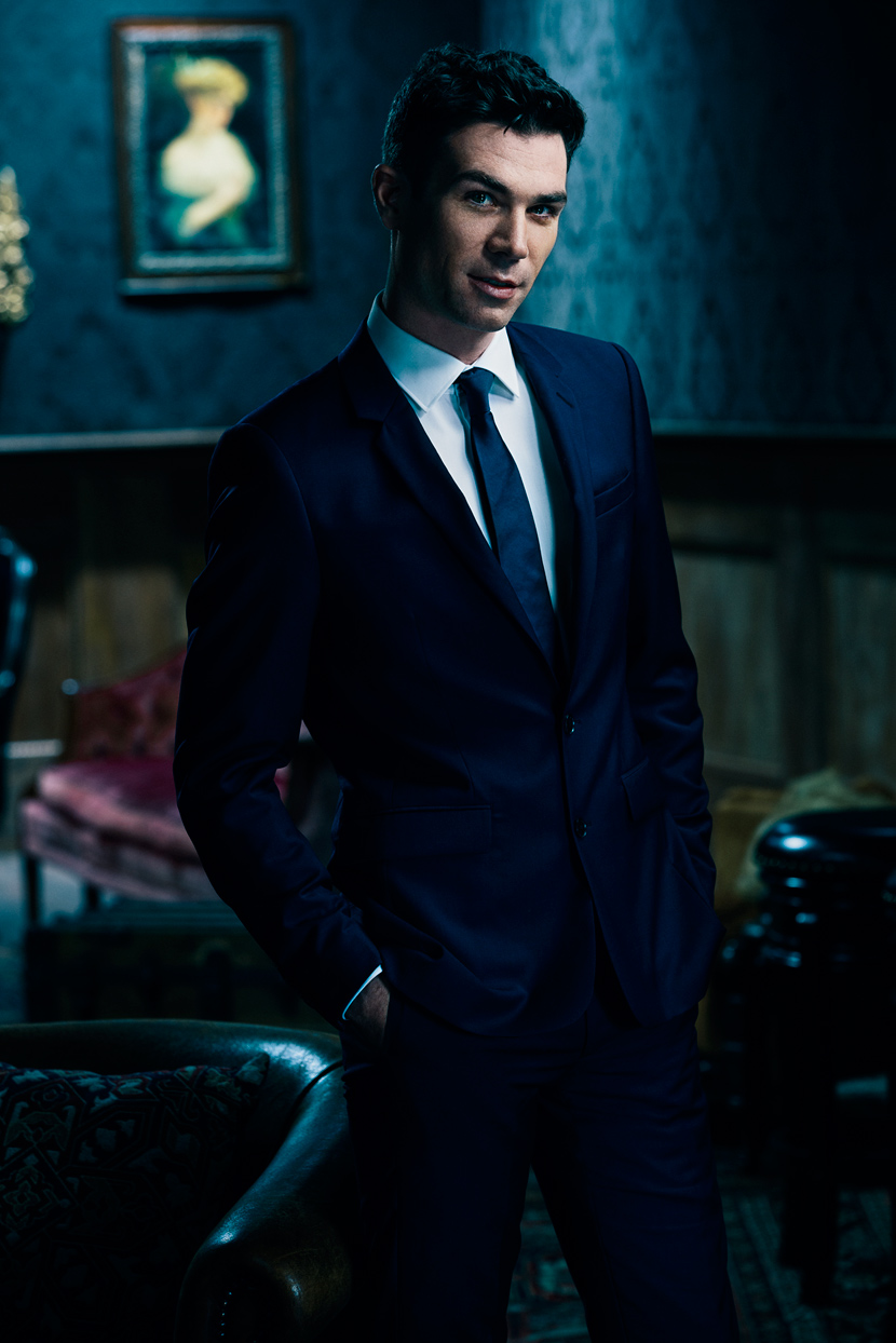 Mark DeLong - Celebrity Photographer - Profile of a male actor in a blue suit.