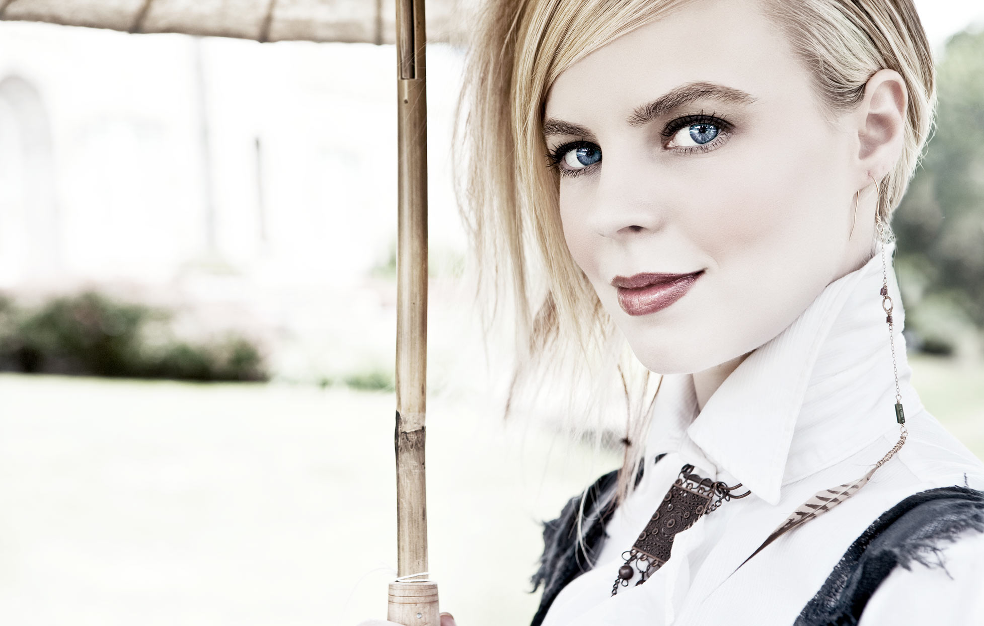 Mark DeLong - Celebrity Photographer - Blonde actress in fantasy clothing holding an umbrella.