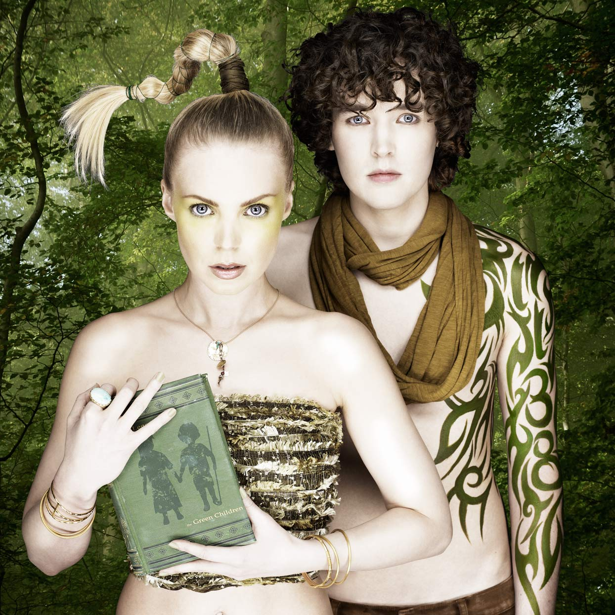 Mark DeLong - Celebrity Photographer - Actor and actress in fantasy clothing clutching book.