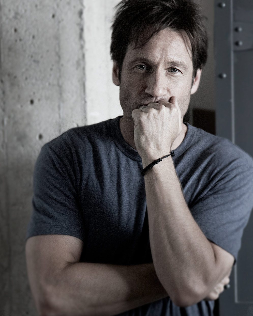 Mark DeLong - Celebrity Photographer - Actor wearing a blue t-shirt ponders.