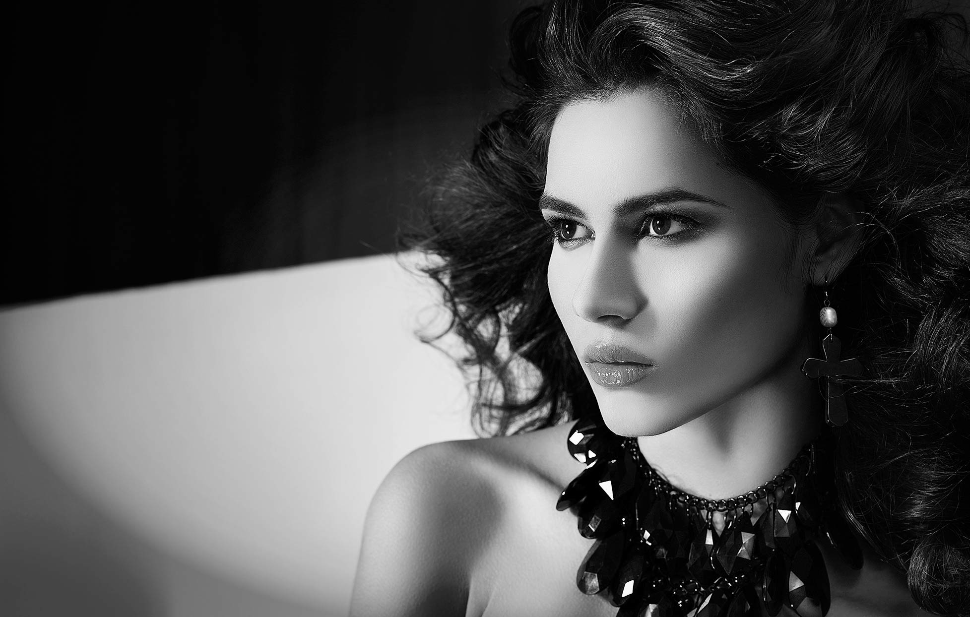 black and white portait of woman looking to the side with fancy black necklace - Mark DeLong: Fashion Gallery