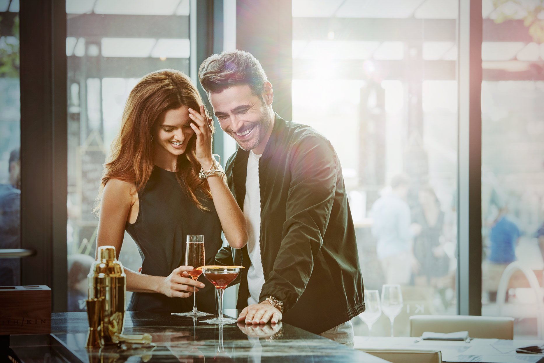 Mark DeLong - Commercial Photography - Couple drinking champagne at a bar.