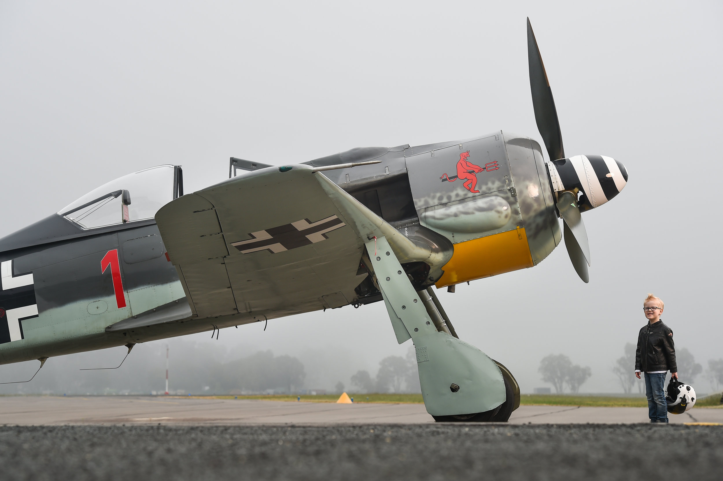 (Photo Mark Jesser/Fairfax Media) Albury Airport, NSW, Australia. One of the world's rarest German warplanes, the Focke-Wulf 190, flown in WWII will be one of the star attractions at the Wings Over Illawarra 2016 Airshow in Wollongong on May 6-7. Owned by Raptor Aviation. PICTURED: James Lane, 5 of Thurgoona (Albury), NSW gets a look at the plane before it takes off to Wollongong.
