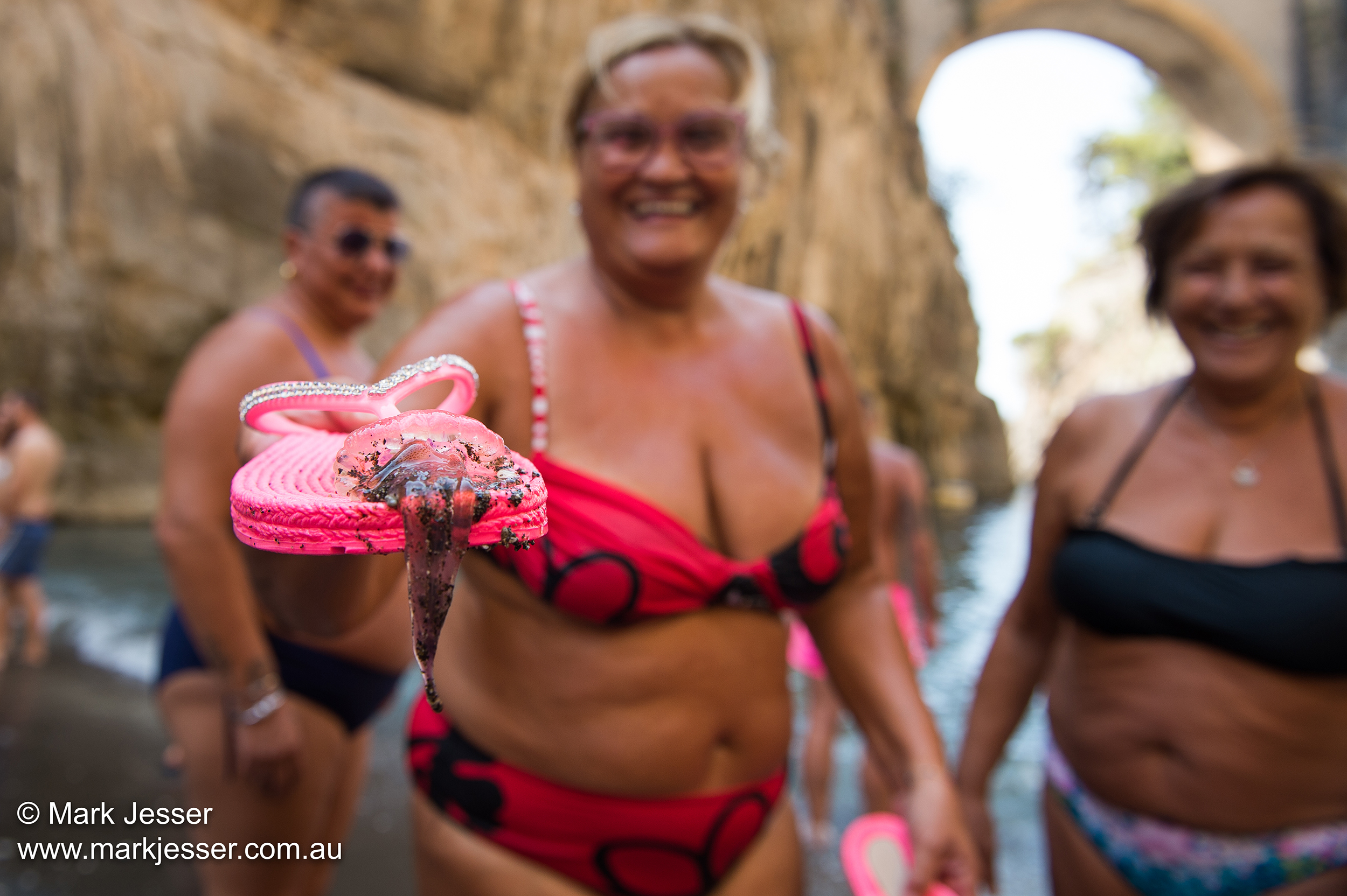 (Photo Mark Jesser) Furores beach, Italy. - Italian women remove jellyfish from the ocean.