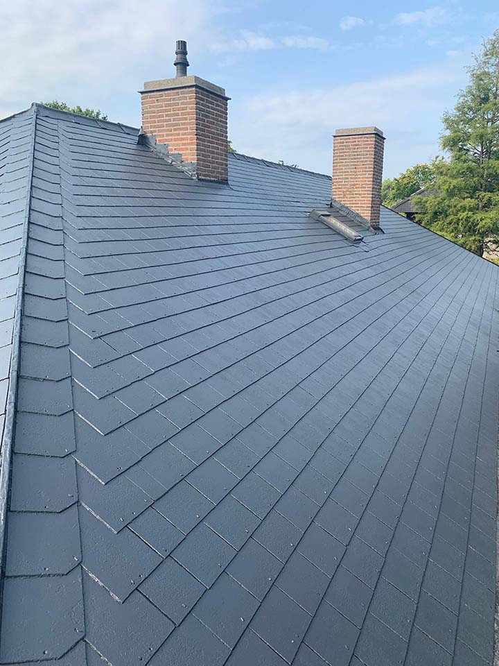 Reinigen dak in leien West-Vlaanderen na.jpeg