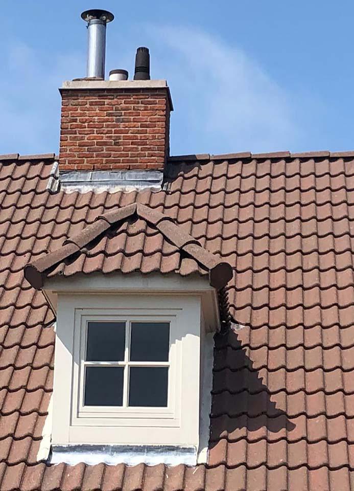 Ontmossen dakpannen Kortrijk na.jpg