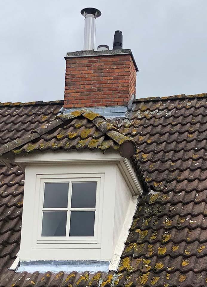 Ontmossen dakpannen Kortrijk voor.jpg