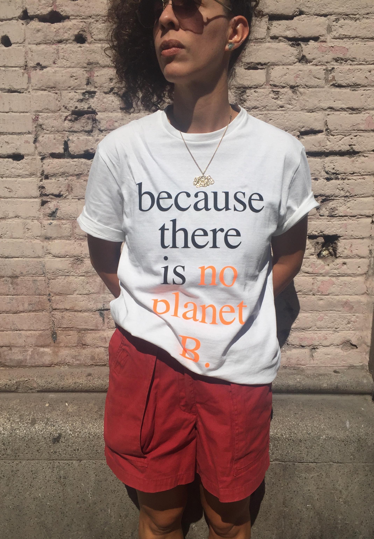 Carla wearing Ecoalf slogan tee