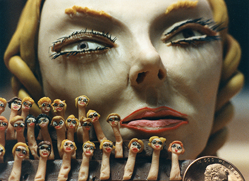 2-Clay Woman with Tiny Heads.jpg