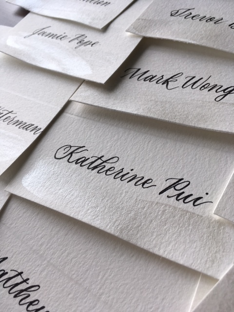 Day-of stationery - Paper goods for your event, often personalized to each guest or something specially handmade to keep as mementosIncludes place cards, table numbers, written notecards, vow books