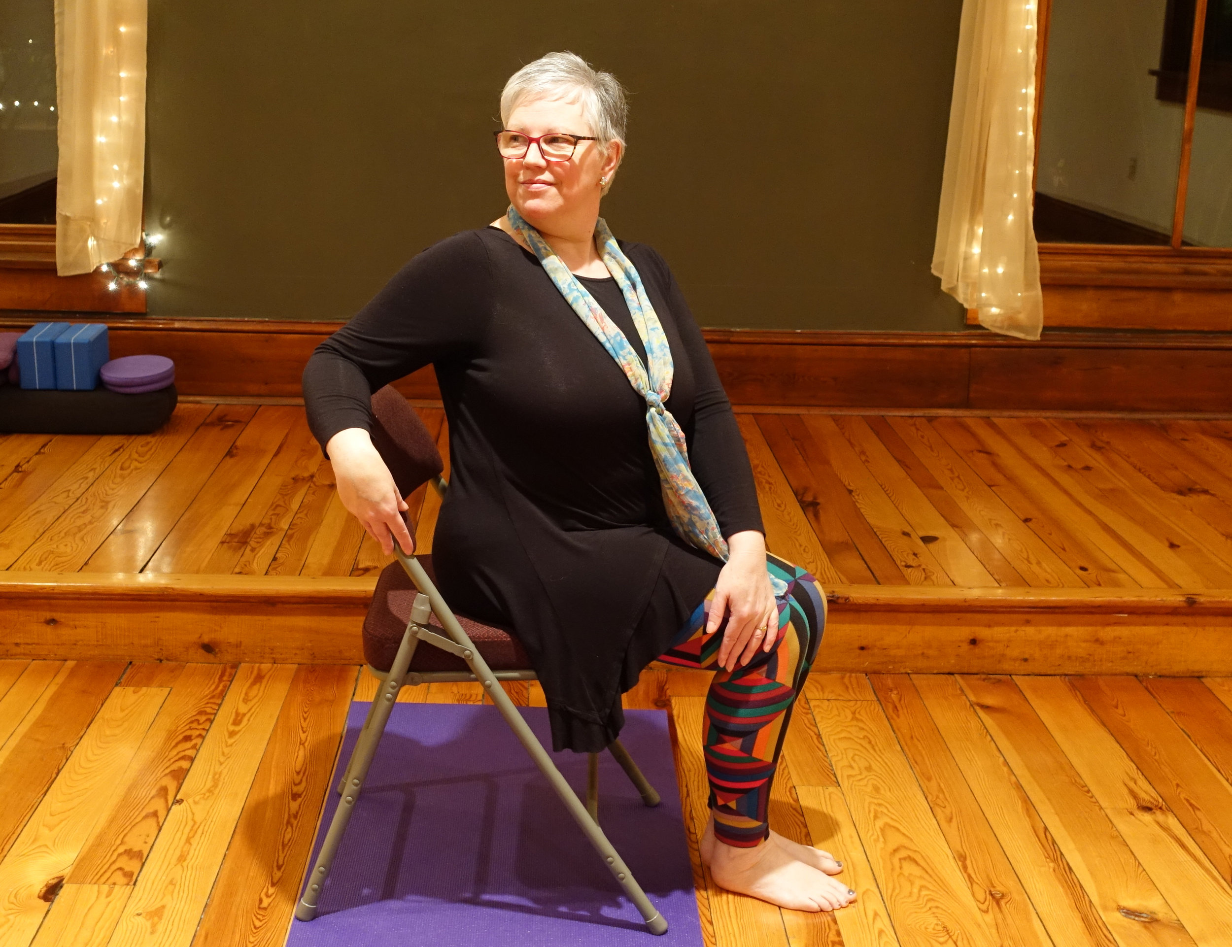 Mairi in Seated Twist in a Chair Posture