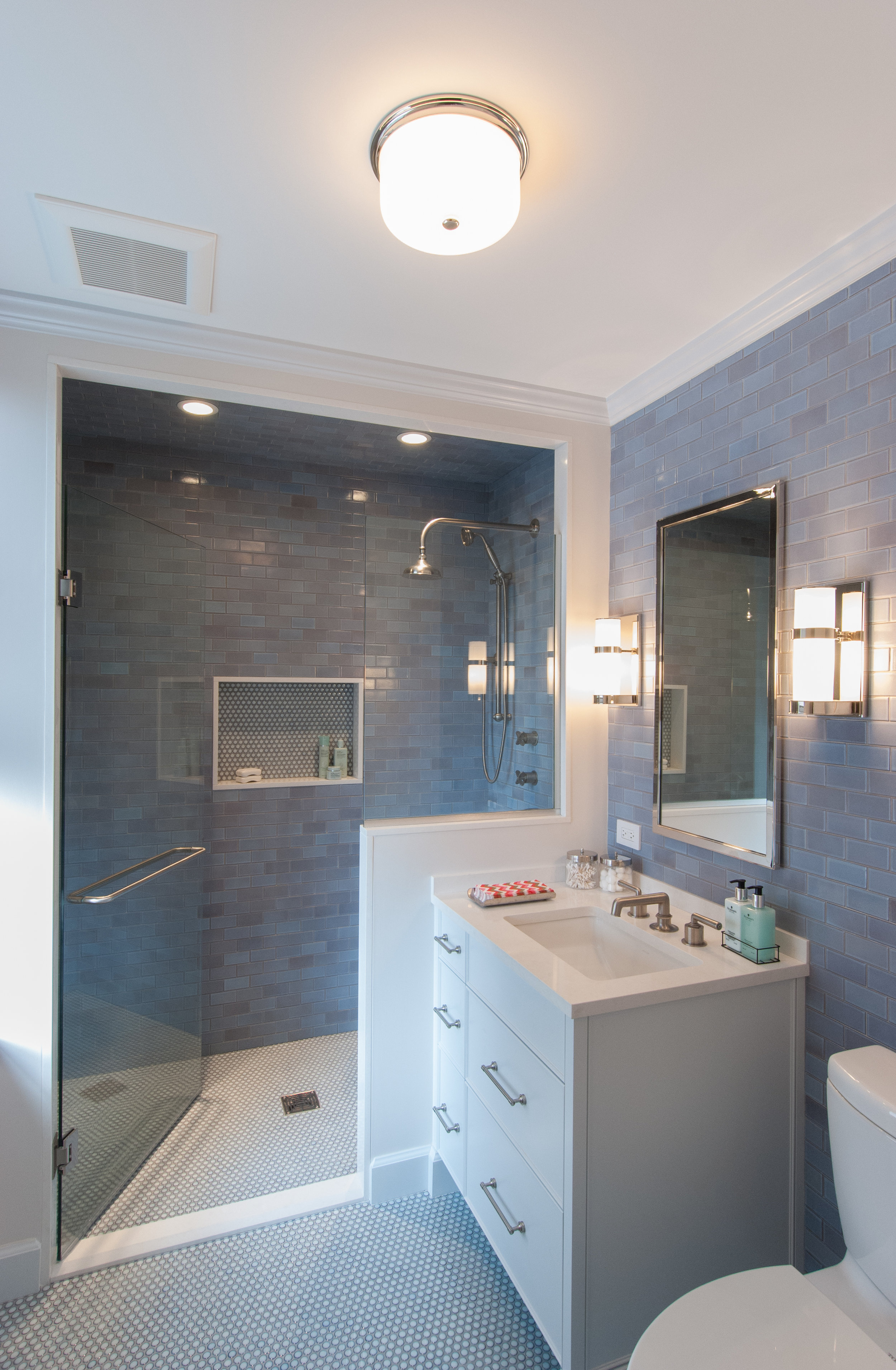 We worked closely with the owner to select the fixtures in all of the rooms. Plumbing fixtures in the master bath are by Waterworks. Tile is Heath Ceramics.