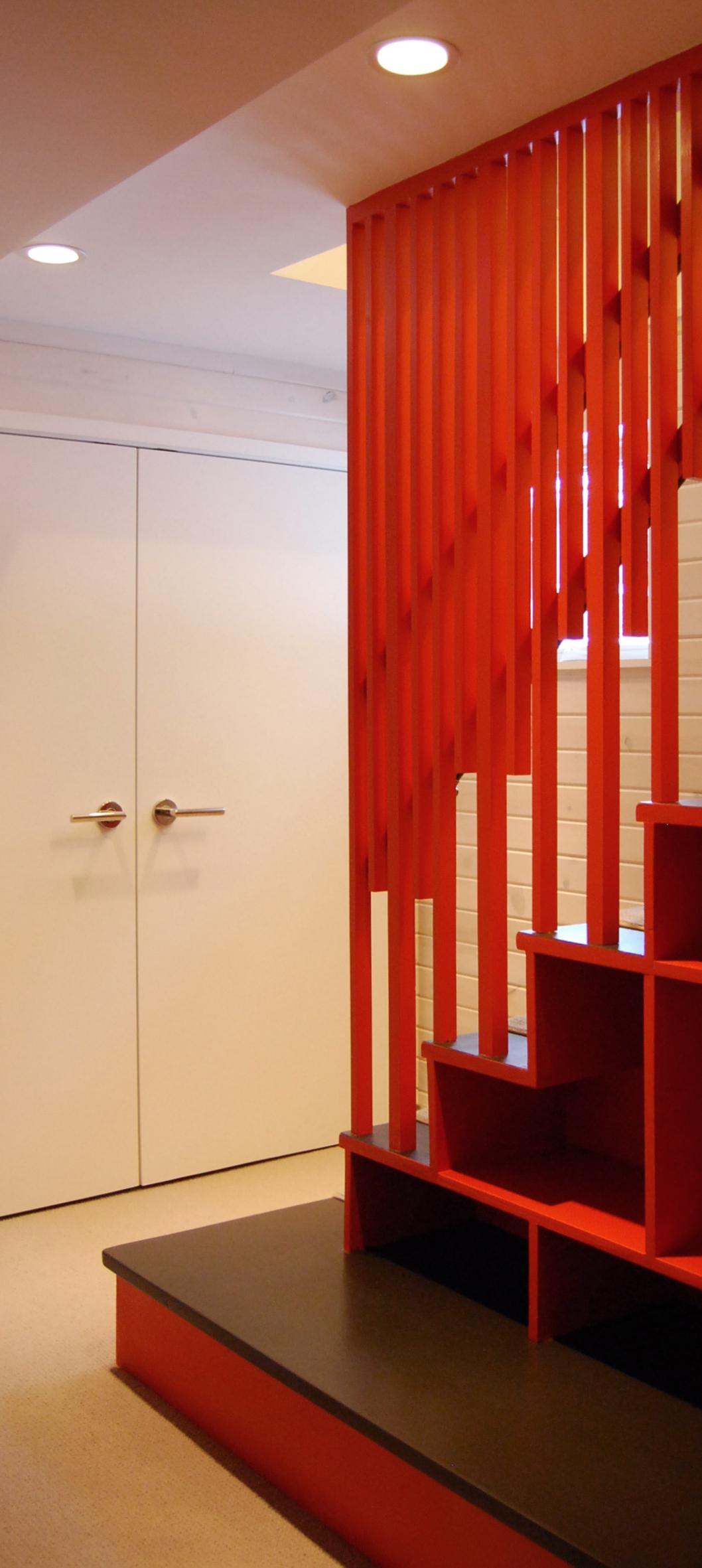 Custom wood stair screen and bookshelf. Carmen Street. Chicago.